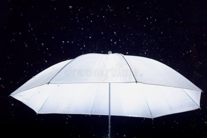 White umbrella with rain.  royalty free stock photo