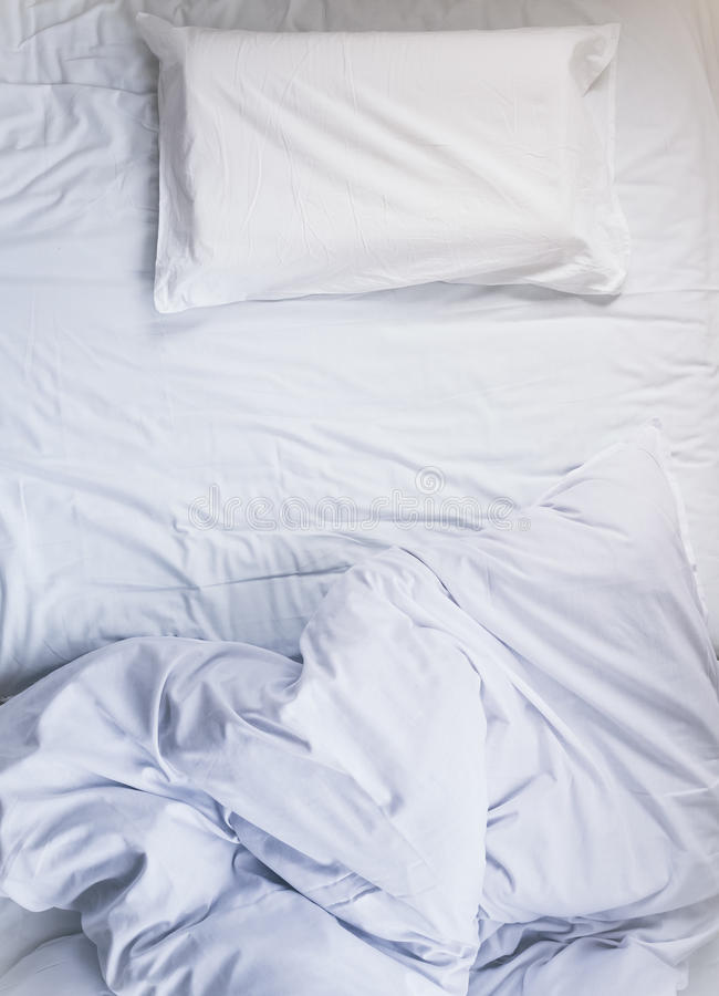 White unmade Bed mattress Duvet with pillow and blanket Top view royalty free stock image