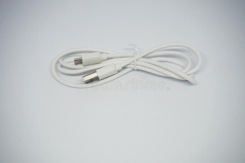 White USB cable charger. White USB wire cable charger royalty free stock photo