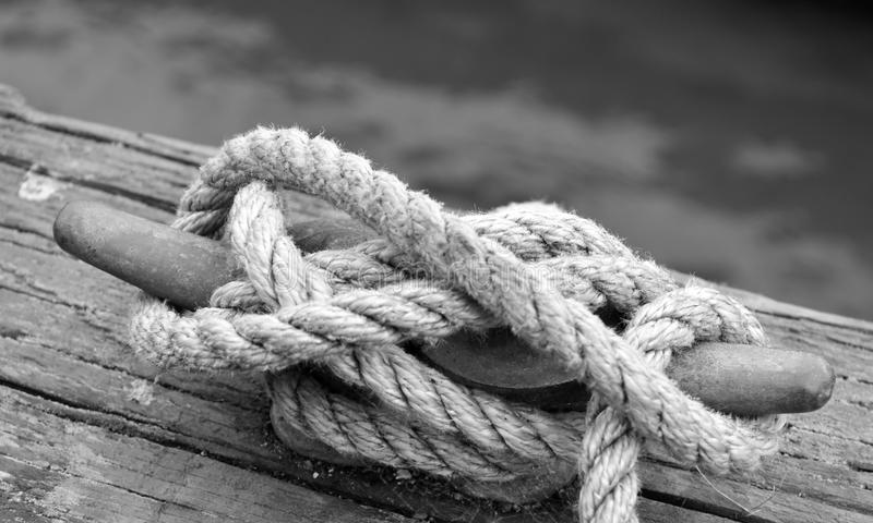 A white used rope fastened on the landing pier royalty free stock photos