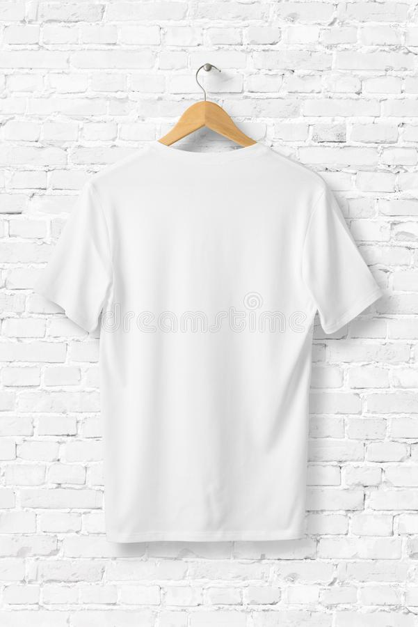 White V-Neck Shirt Mock-up hanging on white wall. royalty free illustration
