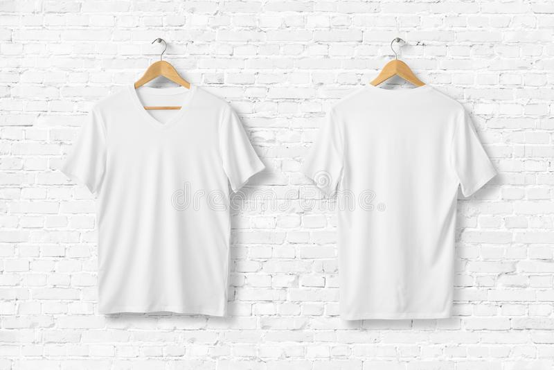 White V-Neck Shirt Mock-up hanging on white wall. royalty free stock photography