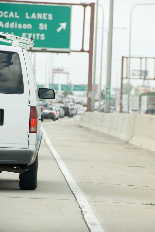White van driving royalty free stock image