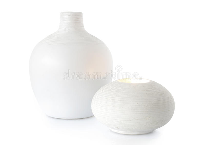 White vase and candle holder. Isolated on white royalty free stock photos
