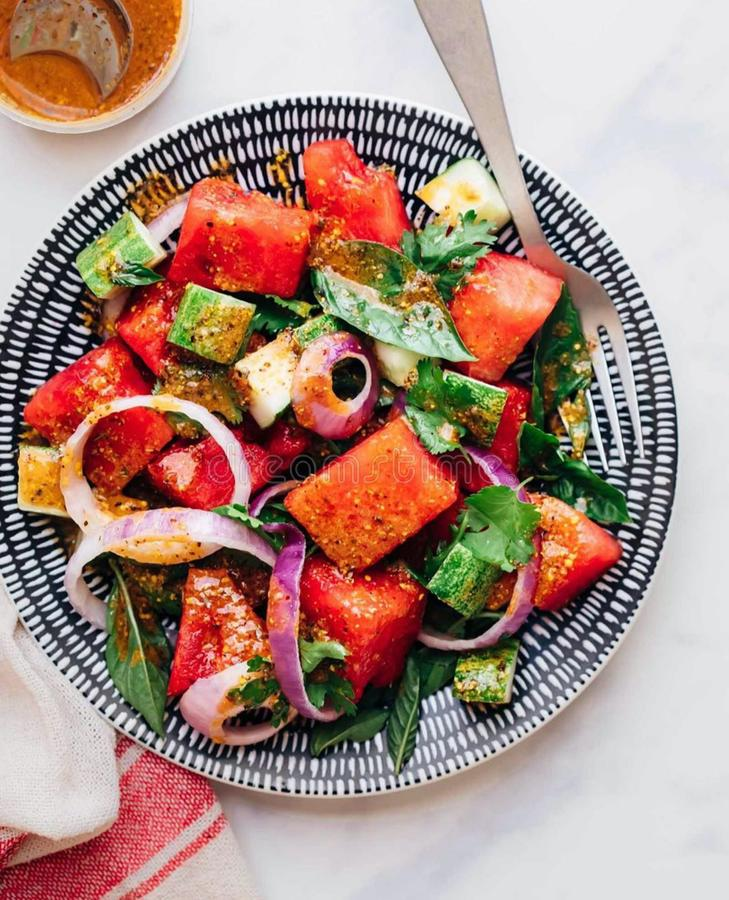 Who else is into watermelon salads right now? stock image