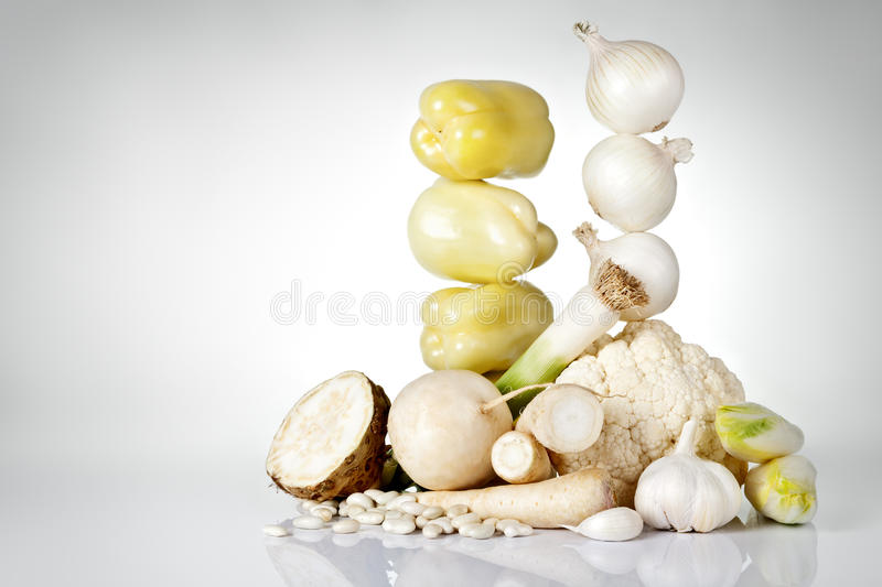 White Vegetables. Fresh white vegetables on gray background with copy space stock photo