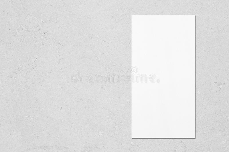 White vertical rectangle price-list or menu mockup on grey concrete background. Empty white vertical rectangle price-list or menu mockup with soft shadows on royalty free stock photography