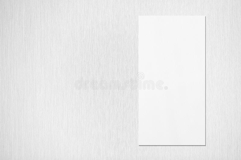 White vertical rectangle price-list or menu mockup on grey textured background. Empty white vertical rectangle price-list or menu mockup with soft shadows on stock illustration