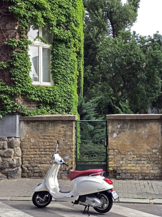 White vespa scooter in Bratislava, Slovakia royalty free stock images