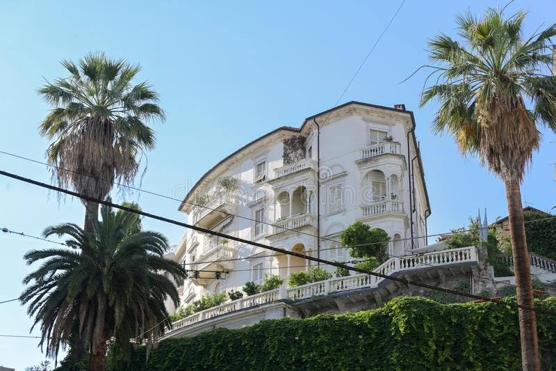 White villa with palm trees on the hill in La Spezia, capital city in Liguria, Italy, copy space. White villa with palm trees on the hill in La Spezia, a capital royalty free stock photos