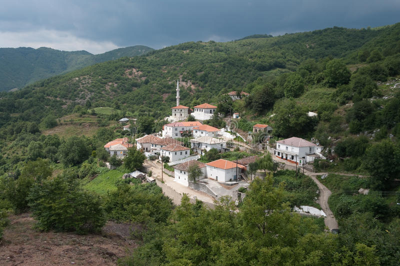 White Village And Mosque In The Thrace Greece. The Sariyerkoy mosque in the hamlet Kidaris, a pomak village of musulman minority in the Thrace Greece between the stock photos