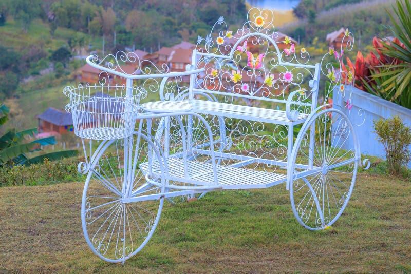 White vintage classic three wheel bike or bicycle. royalty free stock photo