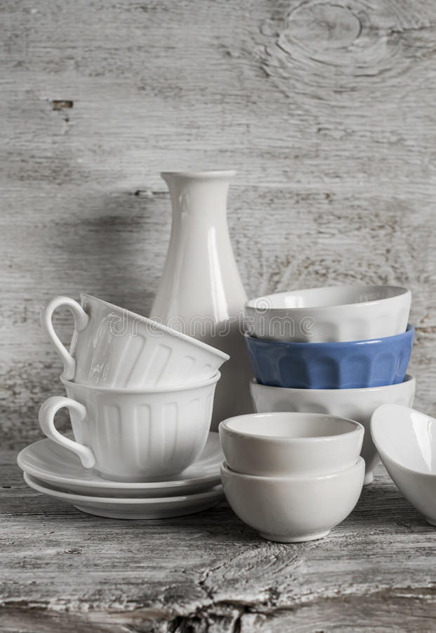 White vintage crockery - ceramic bowl, vase, porcelain tea cups stock photography