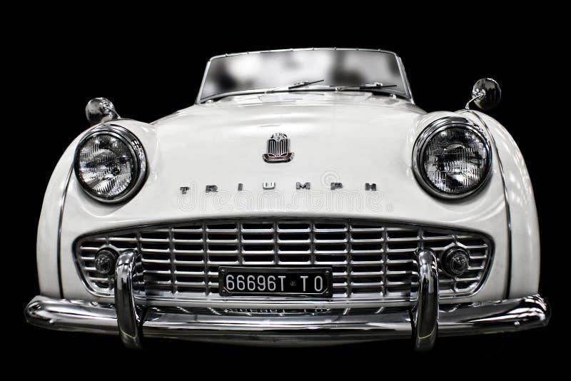 White Vintage Triump Sedan stock image