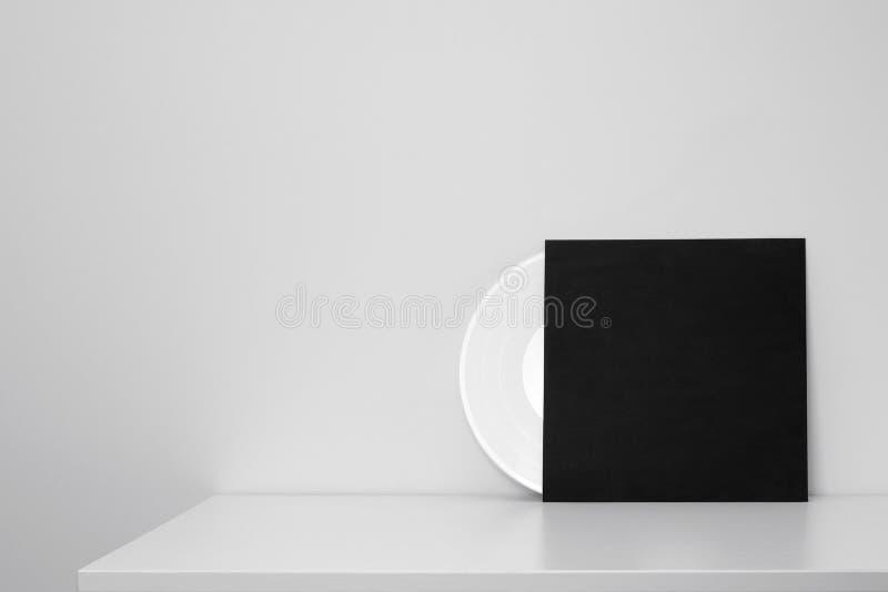 White vinyl record in black paper case stock photos