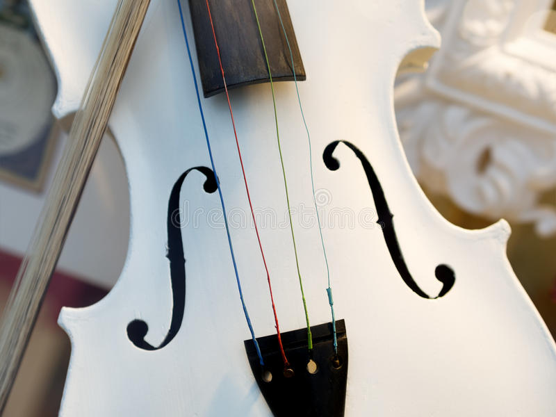 White violin. Image of a white violin with fiddlestick royalty free stock images