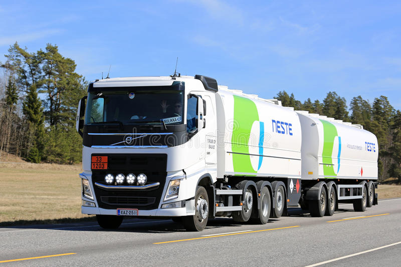 White Volvo FH Fuel Tanker of Neste Road Transport. KAARINA, FINLAND - MAY 5, 2017: White Volvo FH tank truck of Neste hauls asoline fuel along highway in South stock photography