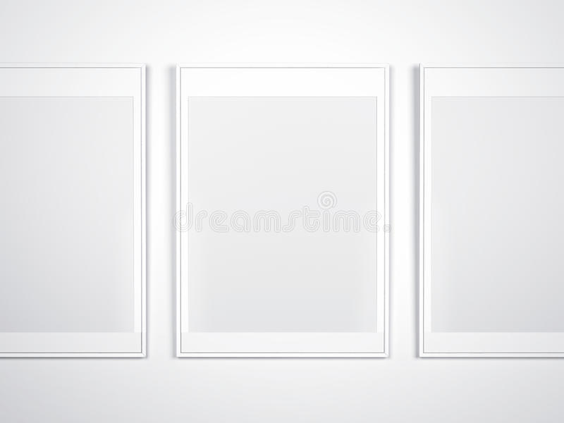 White wall with blank frames stock photography