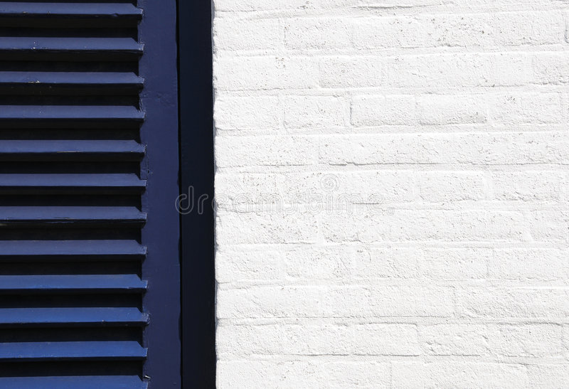 White wall and blue shutter royalty free stock photos