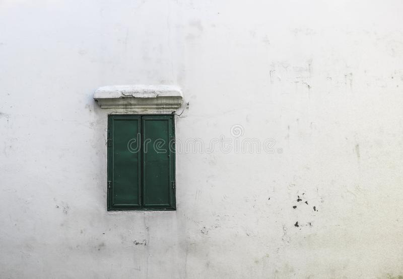 White wall cement dry and green window use for background stock photos