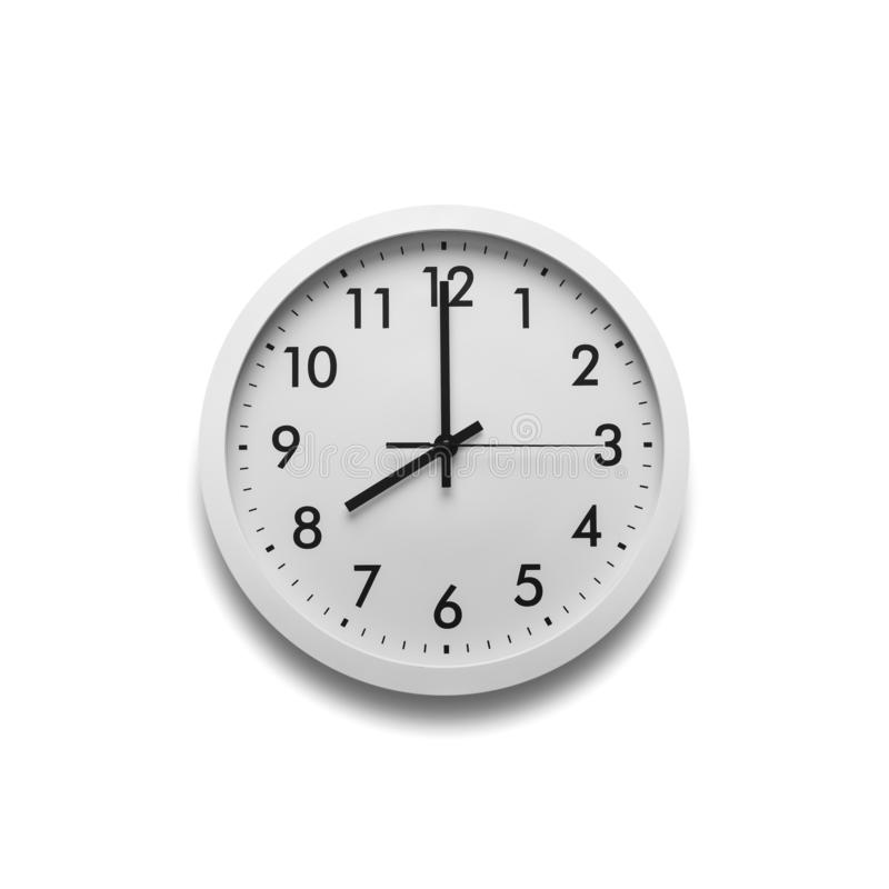 White wall clock isolated on white background. On the clock, eight on the clock stock photo