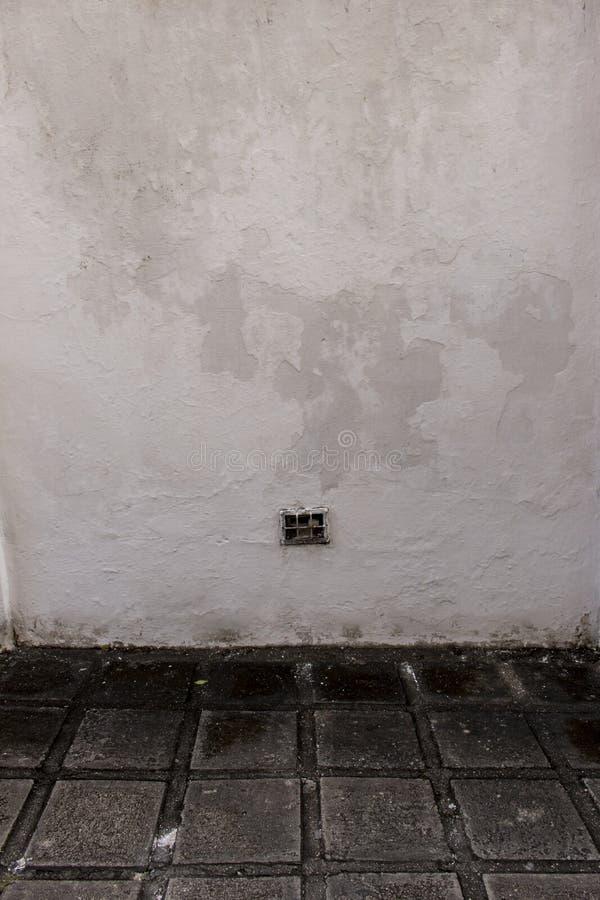 White wall and concrete floor. stock photos