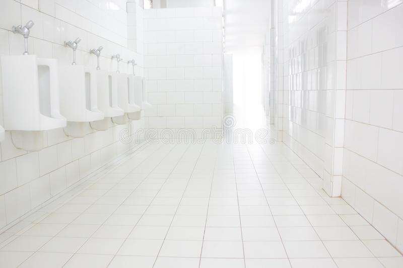 White Wall and floor tiles.White tile floor office With the morning sun, the windows reflect the reflection. White Wall and floor tiles,White tile floor office royalty free stock photography