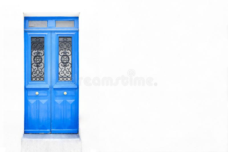 White wall of the house with a closed wooden door in Paris, France. Add your text stock photos