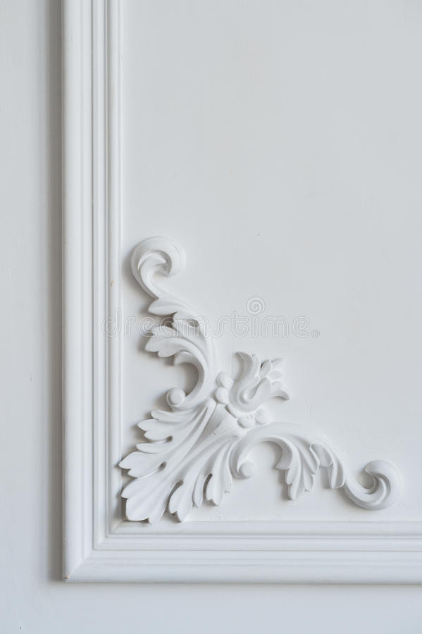 White wall molding with geometric shape and vanishing point. Luxury white wall design bas-relief with stucco mouldings stock photography