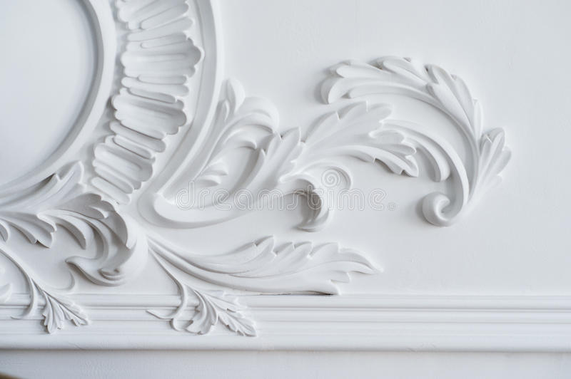 White wall molding with geometric shape and vanishing point. Luxury white wall design bas-relief with stucco mouldings stock photos