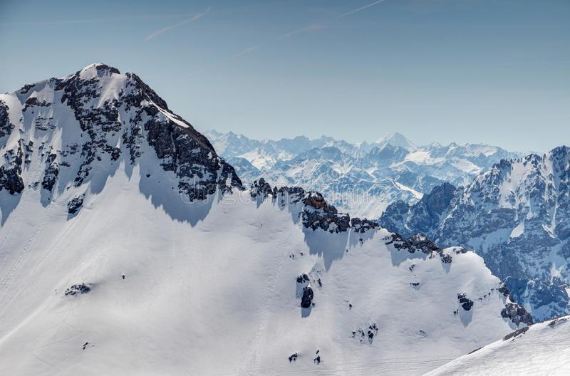 White rock wall in Wetterstein mountains and jagged Stubai Alps. White wall of Plattspitzen peak in Wetterstein mountain with jagged ridges of Stubaier Alpen royalty free stock photography