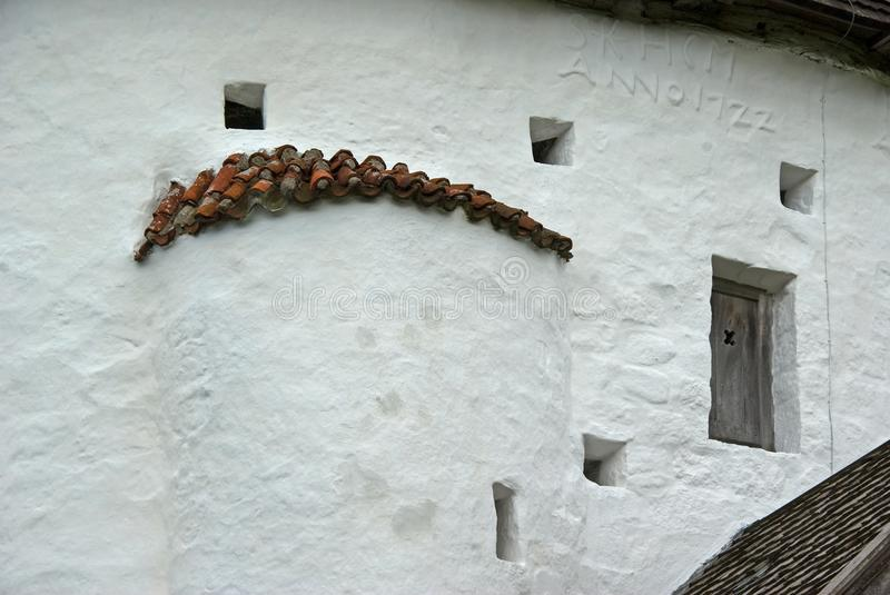 White wall of round church on the island Bornholm. stock photography