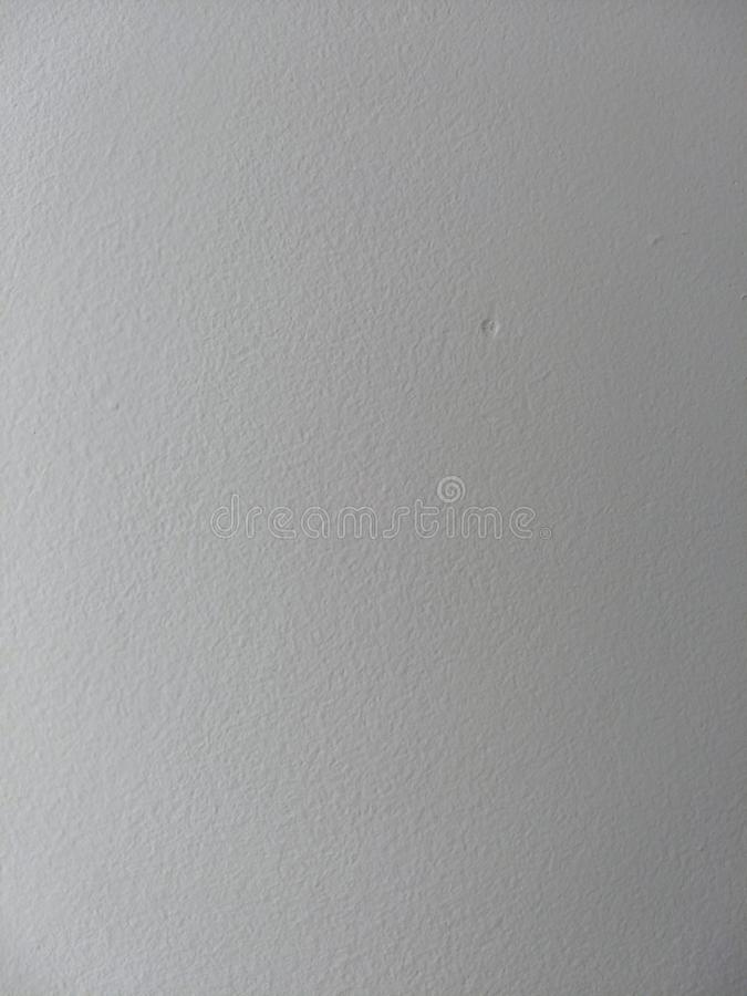 White wall texture with a side lighting. White painted wall texture. With a smooth lighting from the left side of the frame, adding contrast to the texture royalty free stock photos