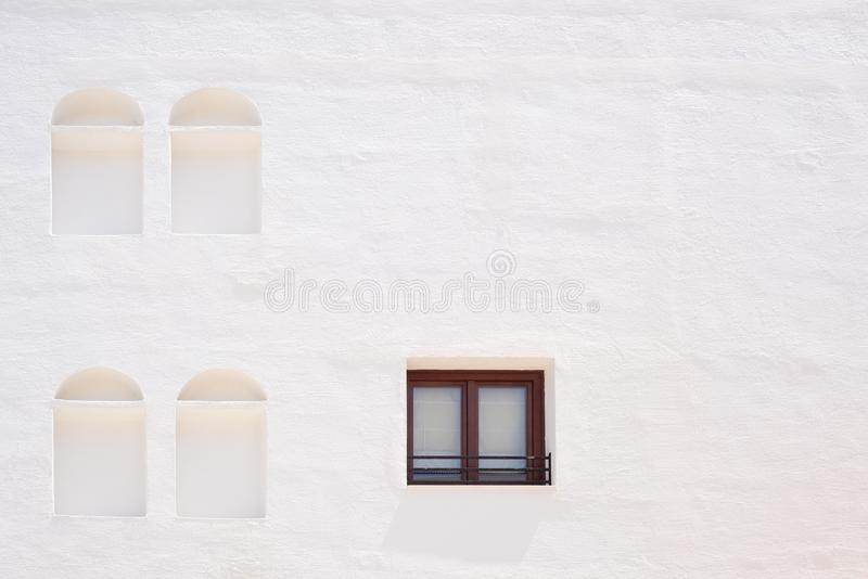 White wall with window and niches. White wall with one window and four niches stock image