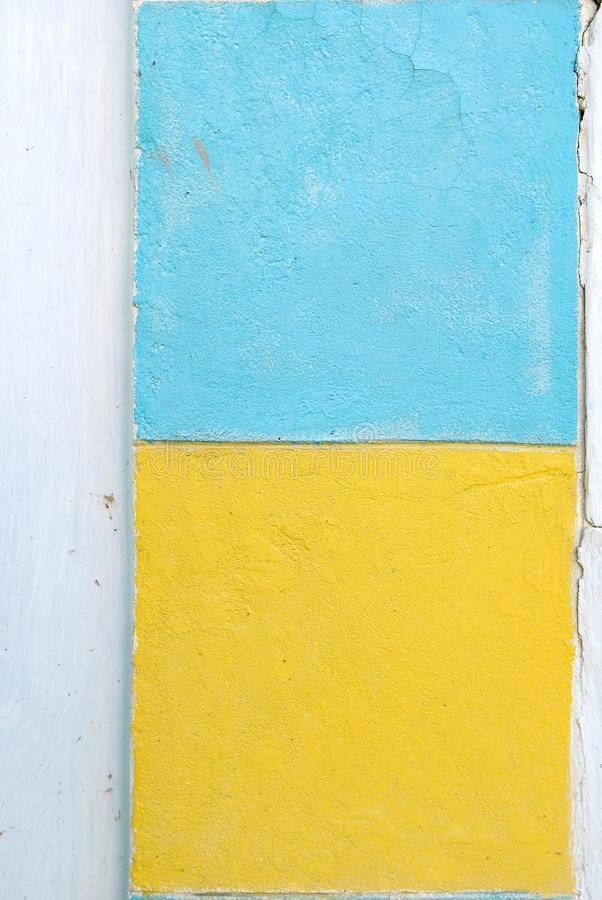 White Wall With Yellow And Blue Paint Squares Stock Image - Image of ...