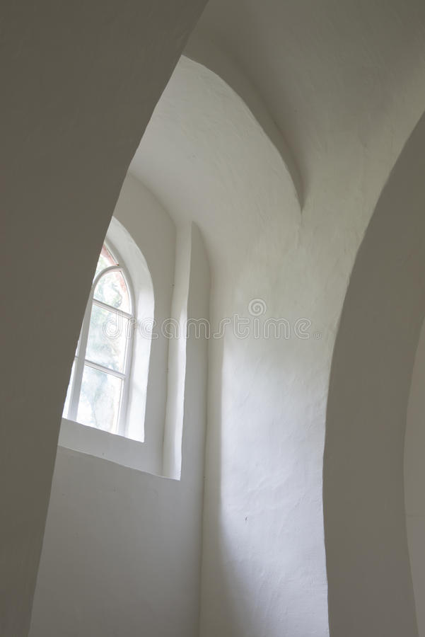 White walls in Church Oostrum. White curved walls and window in the church of Oostrum in the province of Groningen royalty free stock images