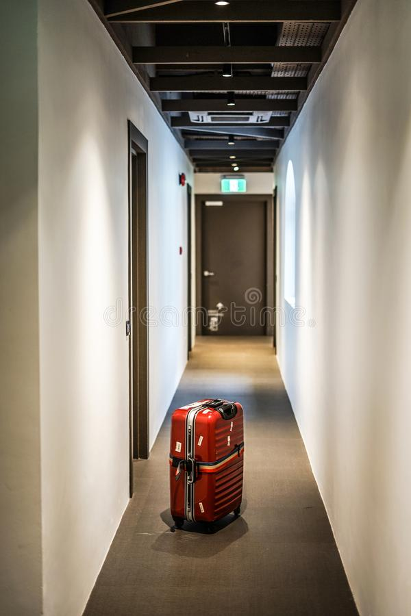 White walls of the corridor and suitcase stock image