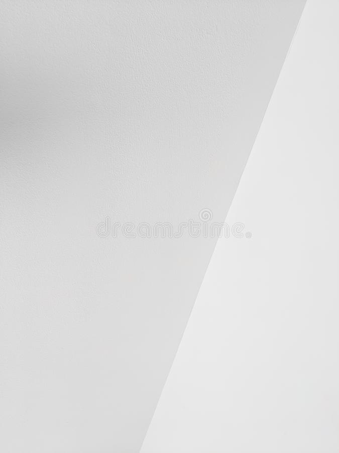White Walls Intersecting for Background. The intersection of white colored walls for backdrop or wallpaper stock images