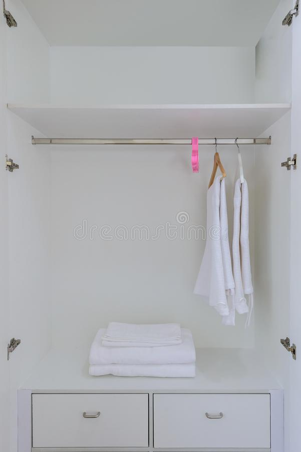 White wardrobe closet. With Hangers, bath robes For guests staying in hotel stock photos
