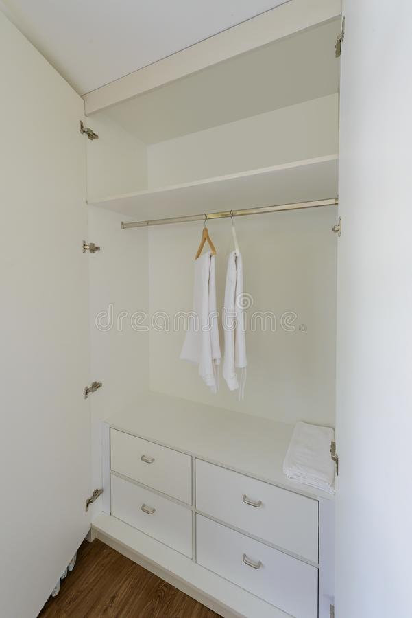 White wardrobe closet. With Hangers, bath robes For guests staying in hotel stock images