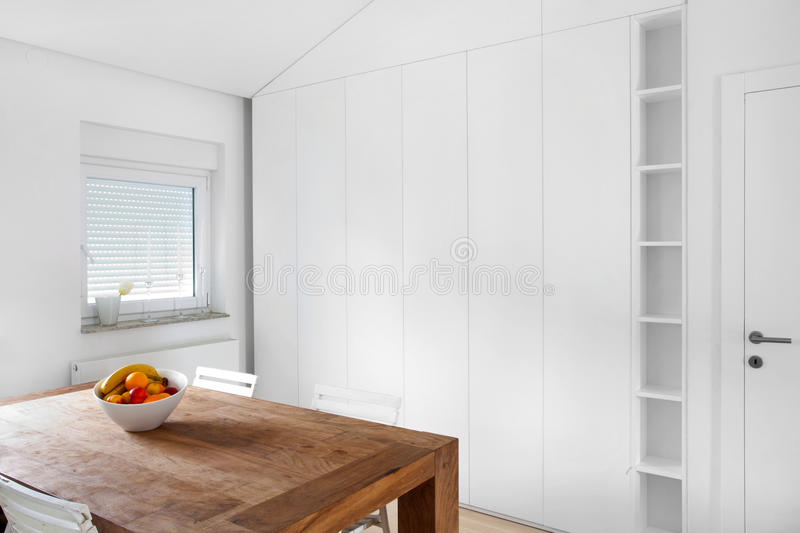 White wardrobe in the dining room. White wardrobe in the rustic dining room royalty free stock image