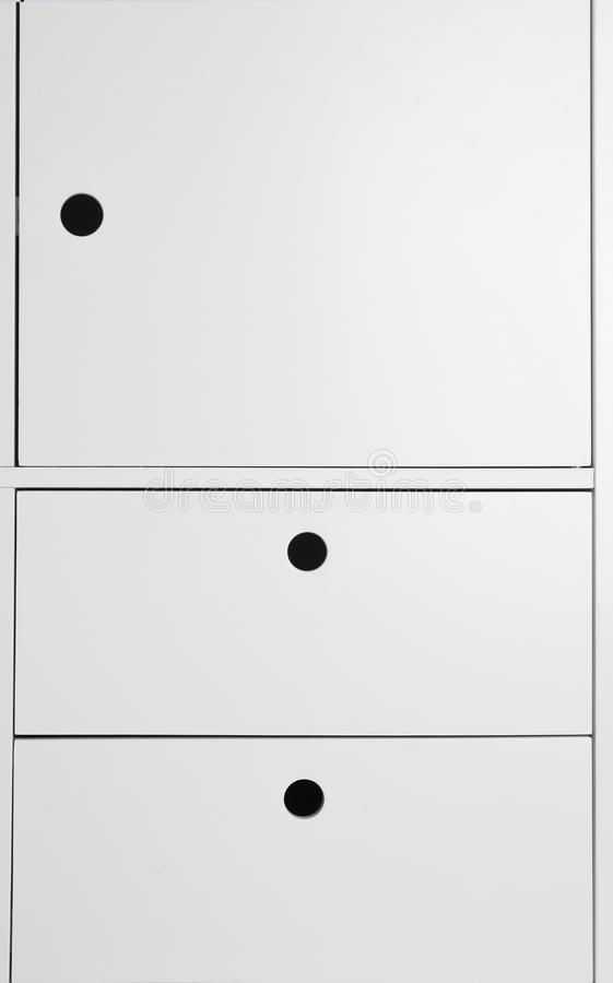 White wardrobe drawers as background. Closeup view royalty free stock images