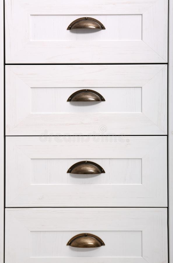 White wardrobe drawers as background. Closeup view stock image