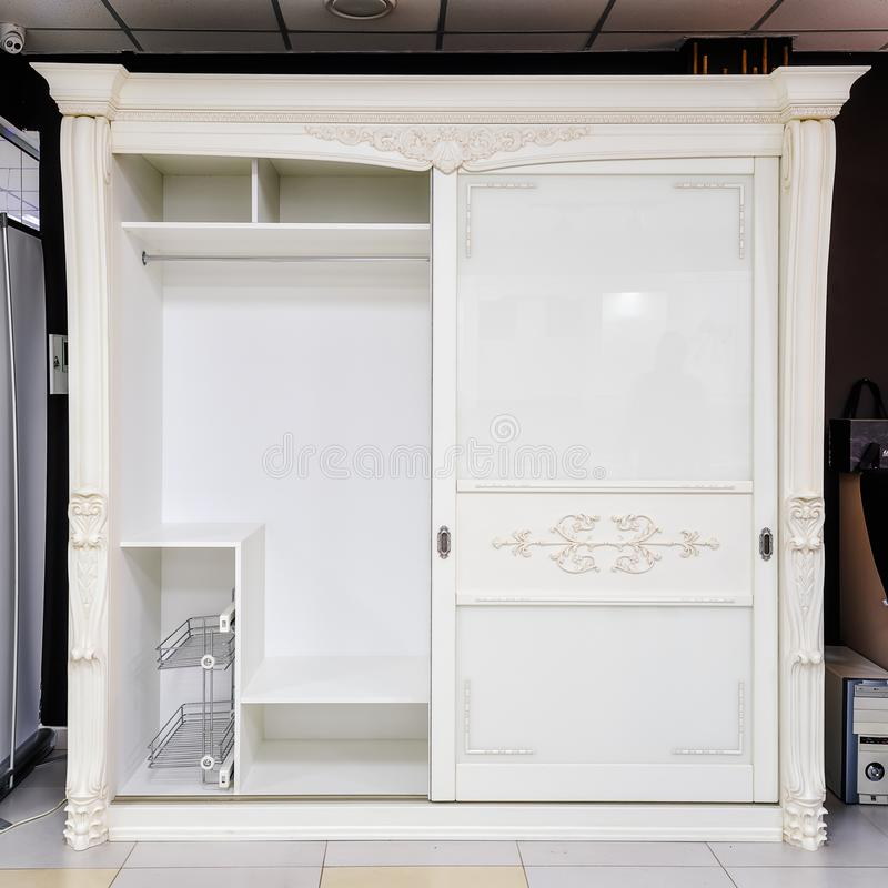 White wardrobe with sliding doors, drawer and shelves, vintage style.  stock photography