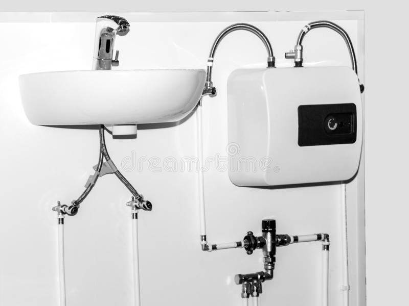 White washbasin for washing hands with water heater stock images