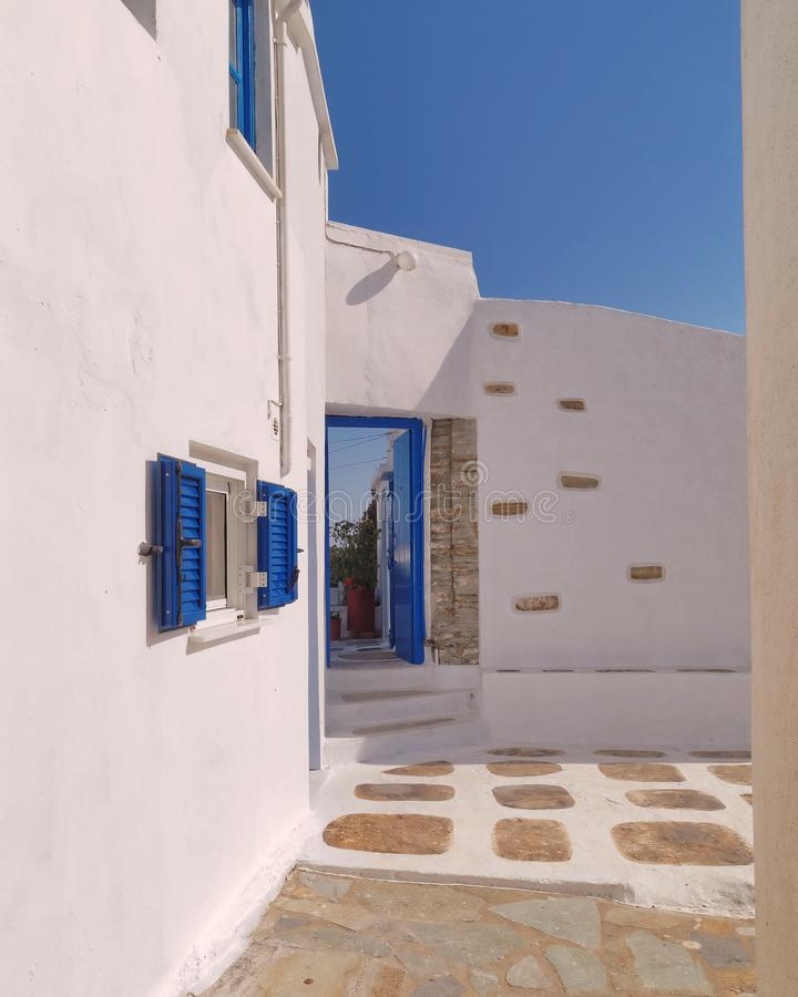 White washed and blue house entrance in a mediterranean island royalty free stock photography