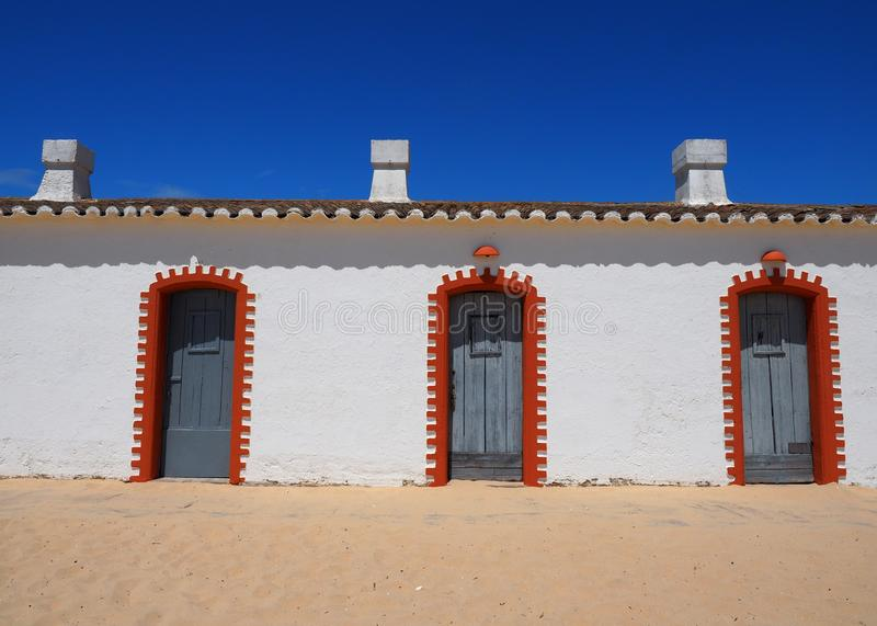 White Washed Buildings With Red Brick Decoration At Praia Do Barril Tavira Portugal royalty free stock photos