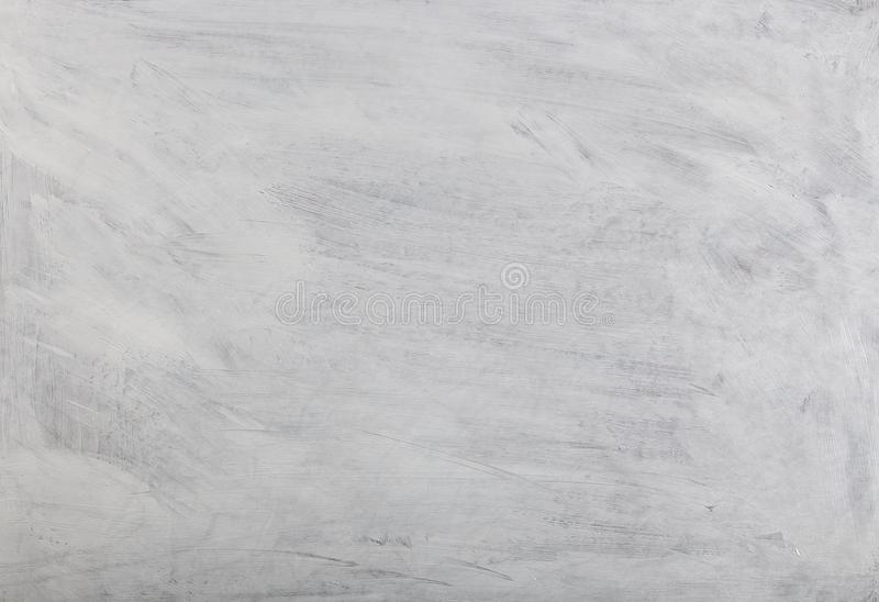 White washed painted textured abstract background with brush strokes in gray and black shades. stock image