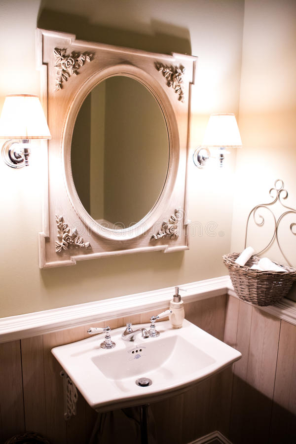 White washstand with large oval mirror stock images