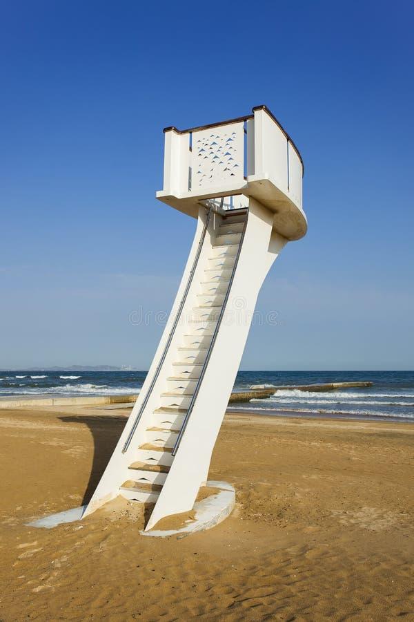 Watchtower on an empty beach with blue sky. White watchtower on an empty sunny beach with a blue sky, Yantai, China stock photos